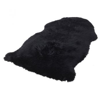 Black Sheepskin Rug HPR004. A stunning sheepskin rug. Great comfort and warmth. Perfect to sit in your living room or bedroom.