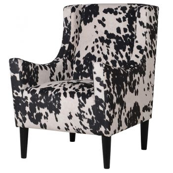 Faux Cow Hide Armchair HZS004. A stunning armchair decorated in faux cow hide. Excellent as a stand out piece in your living room. Would also work nicely in a large bedroom!