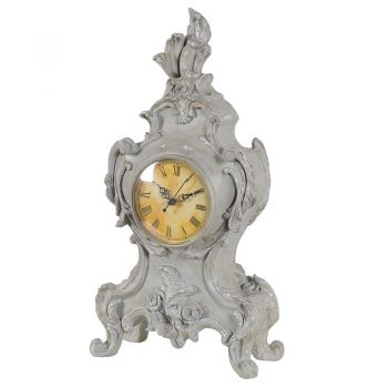 Grey Ornate Clock KMB251. This fantastic grey mantel clock sits perfectly. With the ornate finish, this distressed piece will continue to be an eye catcher.