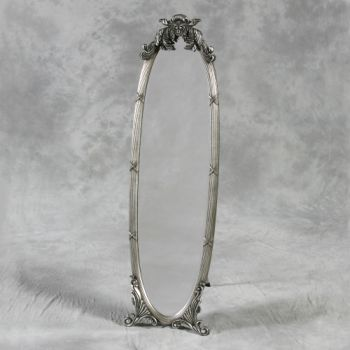 Antiqued Silver Dressing Mirror on Stand M174. This stunning oval silver dressing mirror has a beautiful antique cresting around the edge with fantastic detail on the top and bottom. It would be a great bedroom addition.